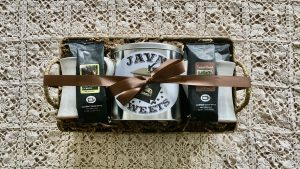 gift basket with coffee, cookies, and mugs
